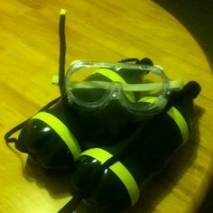 My dramatic play scuba tank and mask...Review of previous learning (who is in the ocean)...idea: Do plants sustain life in the ocean, too?  Are alga plants?  (use criteria for assessment)