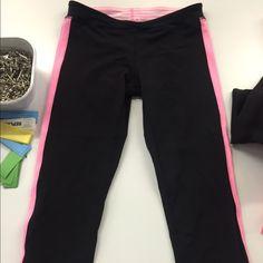 Lululemon Crop Pants Black Lululemon crop pants. Pink stripe down the side. Barely worn lululemon athletica Pants Ankle & Cropped