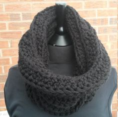 A super thick chunky warm infinity scarf handmade in classic black. It is snug, cosy and will match any outfit for any occasion. It can also be worn either side (reversible) Can be stacked high around the neck and is very stretchy giving you lots of space to fold over for a shorter look. Perfect as a lovely gift for a special occasion. mothers day, birthdays, any lady that loves to accessorise, or a treat for yourself ! It can be worn in various ways as shown in the photos - Straight chunky…