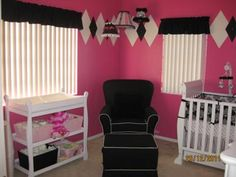 Our Baby Girl's Pink Black and White Nursery: As you can see our pink, white and black argyle nursery decor is very different, vibrant and bold! We were so fortunate to have such amazing painters which,