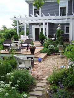 yes please...like color of house & pretty trellis ... but the deck needs to be more one level to flow...too small a square & can't really use brick area.. better if there was a double step down to one large bottom area...more useful & not so broken up.