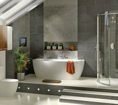 Bathroom Ideas:Modern Small Bathroom Design With Small White Free Standing Porcelain Bathtub And Curved Sliding Door Shower Screen And Fresh Green Indoor Garden On Modern Silver Ceramic Potted Plants Small Bathroom Design Trends, Bathroom Designs for Small Spaces