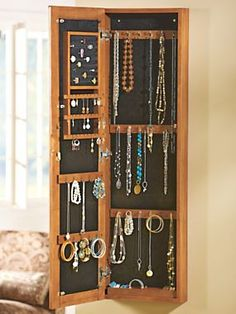 This full-length mirror elegantly stores all of your jewelry! | Solutions.com #Jewelry #Storage #Organization