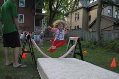 Obstacle course fun for parties-- I knew there was a reason we still hadn't gotten rid of the old crib mattress!