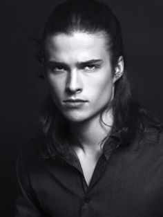 This photo showing model Wyatt Kyte reminds me, in the set of his features and his expression/gaze, reminds me of what Thomas Ryder looked like as a young man (his current appearance in my story would involve some mental aging/extrapolation). The resemblance is even clearer in some of the colour photos, especially a couple with his hair tied back (because, believe me, little details like that really help for visualizing characters!)…