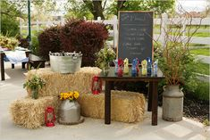 I like the haystacks, flower arrangements and chalkboard for maybe near the parking area for people to walk by before getting to everything