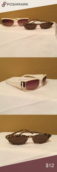 Fun Sunglasses One pair is an elegant cream and gold, the other is a fun fabric tiger stripe. Accessories Sunglasses