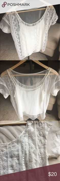 American Eagle Sheer Top American Eagle sheer top with attached cami inside. Creamy white. Size medium. Great condition! American Eagle Outfitters Tops