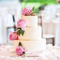Buttercream wedding cake Lake Geneva Country Club in Lake Geneva Wisconsin. Buttercream  cake with a gold band and fresh peonies