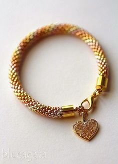 blueagata: 5 shades of gold bracelet with openwork heart.