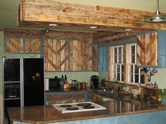 Reclaimed Kitchen Cabinets - Pallets used to reface the cabinet doors. With Love From My Talented Husband