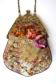 A beautiful Crazy Patchwork purse with dimensional hand dyed silk velvet flowers, silk chenille roses and leaves, diamonte and bead embellishments and subtle silk thread embroidery.
