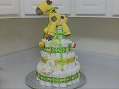 How to make a Diaper Cake. These are so FUN and make a Great Baby Shower Gift or a Center Piece for a Baby Shower. Cost was Under $50 and so Easy and Fun to do! Supplies: Pampers Baby Powder Baby Shampoo Baby Oil Rubber Bands big & small Ribbon Receiving Blankets Hot Glue Gun Booties Decals or Stick-ons