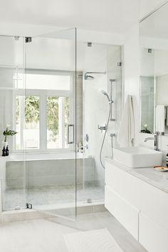 bathroom inspiration // glass shower doors and oversized grey tiles