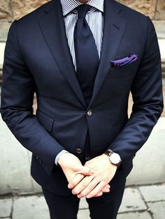 Conservative dark navy outfit.  Like the splash of color from the pocket square.