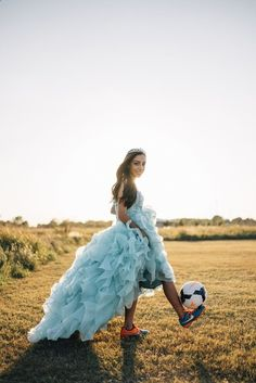 A big puffy dress on a soccer field? Now that's attention grabbing! If you play a sport or you're known as the biggest fan of a certain team, show off your skills or pride on the field. - See more at: www.quinceanera.c...