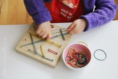 DIY toddler activity: wooden board with screws and rubber bands