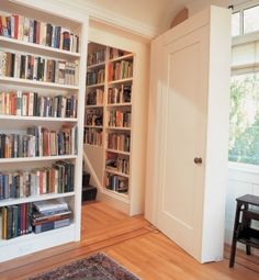 Secret staircase hidden by bookcases on decorative inlaid hardwood floors Photo: Randy O'Rourke, New Rooms for Old Houses, Frank Shirely; Courtesy Taunton Press by ana.sirbu.79