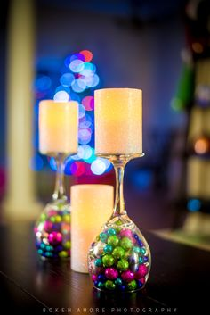 DIY Christmas Decorations -Wine glasses we had at home -Little ornatments from Hobby Lobby -LED Candles from Home Depot. Put some clear tape on the bottom so the ornaments dont fall out.