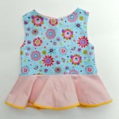 free sewing pattern:  The peplum top for girls, sizes 12 to 8 years.