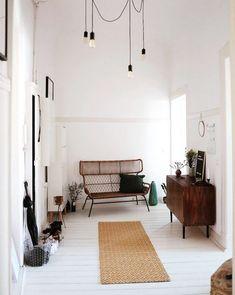 rattan loveseat and hanging black lights in berlin home via my scandinavian home. / sfgirlbybay