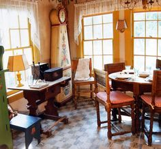 "The breakfast table in the ""Hen House"" kitchen designed by Wilson Claggett...see the clock"