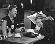 """Mickey Rooney tells Judy Garland a funny story on the set of Metro-Goldwyn-Mayer's """"Babes on Broadway"""", and breaks up a rehearsal."""