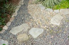 Reflexology Path | Each color represents a degree of difficulty in this reflexology path. Take a rest on the larger stones before moving on. | Plan-it Earth Design Landscape Architects & Designers
