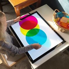 light table with circles and geometric solids