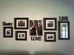 My family room wall... I love this wall in my house and can't wait to add more pictures to it!