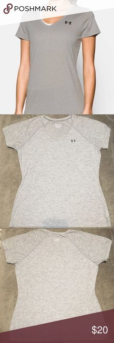 NWOT Under Armour Tech Heatgear Shirt Under Armour Tech Heatgear loose fitting shirt. Never worn, but tags removed. Size medium, but since is made to be big, may fit a large. Light gray - color is best depicted in the picture of the label/size. Perfect for the gym, or just casual wear. Under Armour Tops Tees - Short Sleeve