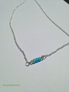 $12.00! Blue Sea Glass Necklace Pale Blue Beads and Champagne Swarovski Crystals Beautifully strung on small wire bar and a15 inch neckchain. by MermaidsMadness on Etsy