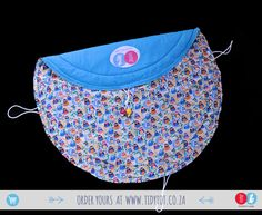 Tidy Tot  We all know that kids could'nt give a hoot about tidying up their toys. You cannot help but love this TIDY TOT withs its dozens of bright primary coloured funky wise OWLS. What better place to store your little one's treasures then in this fully PADDED, very functional TIDY TOT. T-HOOOO cute.  www.tidytot.co.za | The Play Mat That's a Toy Bag Wise Owl, Tidy Up, Primary Colors, Owls, Gym Shorts Womens, Toy, Bright, Owl, Game
