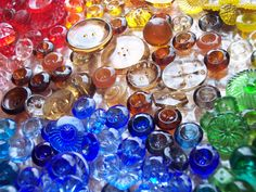 learn something new every day...did not know about Depression glass buttons...beauties