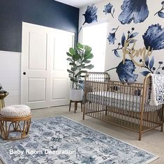 Favorite Nursery Trends of 2018 This navy nursery is gorgeous with that floral wallpaper and brass / gold accents.This navy nursery is gorgeous with that floral wallpaper and brass / gold accents.