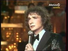 ▶ Michel Sardou en chantant - I love this song, although it wouldn't be appropriate for high school!