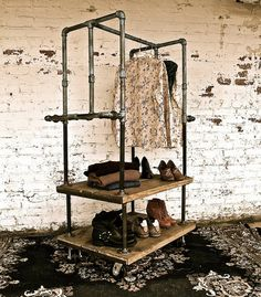 Industrial Pipe Shelving at ModVintageLife.com....Great idea for the laundry room, or if the kids needed extra closet space☺
