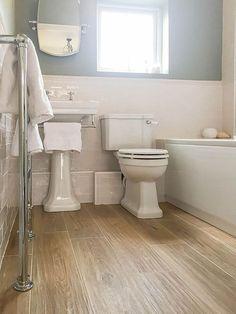 Wood floor bathroom this lengthy white bathroom features rich dark hardwood flooring Metro Tiles Bathroom, Wood Floor Bathroom, Bathroom Colors, Bathroom Flooring, Bathroom Interior, Bathroom Ideas, Floor Grout, White Bathroom Tiles, Stone Bathroom