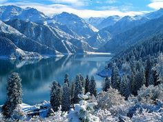 Heavenly Lake is nestled high in the Tianshan Mountains, 115 kilometers miles) west of Urumqi in Xinjiang, China. The area is one of the few unspoiled places in China. Bob Ross, Beautiful Places In The World, Places Around The World, Amazing Places, Winter Szenen, Winter Travel, Winter Time, Beautiful Forest, Beautiful Scenery