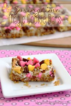 Springtime Magic Cookie Bars are a soft baked graham cracker cookie bar topped with coconut, pecans and Springtime morsels! What a week, y'all! Köstliche Desserts, Delicious Desserts, Dessert Recipes, Chocolate Recipes, Coconut Chocolate, Chocolate Bars, Yummy Treats, Sweet Treats, Magic Cookie Bars
