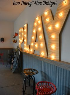 PLAY up in lights. Just in case they don;t get the idea! Made with battery powered LEDs and plywood