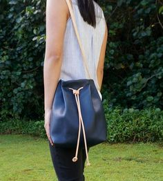 navy leather bucket bag, roomy and versatile with adjustable strap