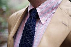Navy knit neckwear.