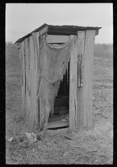 Privy of sharecropper's farmstead near Pace, Mississippi. Background photo for Sunflower Plantation (1939 Jan)