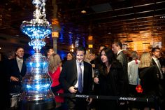 crew party in San Diego featuring the America's Cup Trophy (photo: Gilles Martin- Raget / ACEA / www.americascup.com)