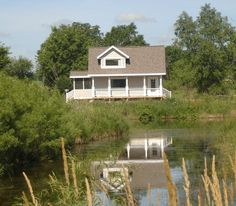 A Secret Cottage, Oxford Wisconsin. On private water on secluded country acreage. Come stay at this quiet peaceful romantic Wisconsin cottage and reconnect. It is perfect for a romantic get-a-way, anniversary, honeymoon, or just some solitude away from the busy world. This enchanting cottage sits in a pristine natural setting. You will be in the only cottage on a private fish stocked lake.