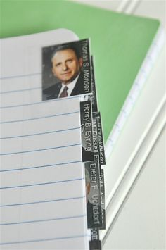 General Conference Journal for note taking - pages are tabbed with photos of General Authorities.
