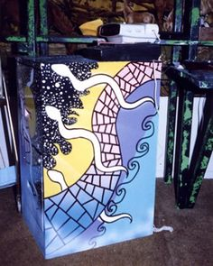 Painted File Cabinets: This wild creative design is called REPTILES IN SPACE; painted file cabinets used in the company office. Hand painted furniture from the online artists portfolio of Don Smith.
