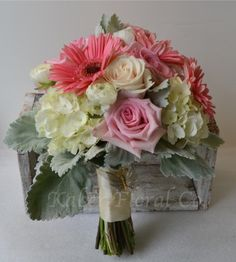 Roses, Gerbera Daisies, Dusty Miller, and Hydrangea. Such a soft and sweet look
