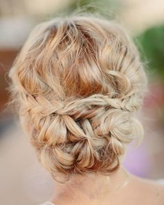 Braided and twisted chignon: http://www.stylemepretty.com/colorado-weddings/2015/01/15/rustic-farm-to-table-wedding-inspiration/   Photography: Cat Mayer - http://www.catmayerstudio.com/